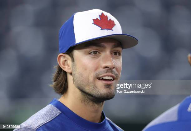 Randal Grichuk of the Toronto Blue Jays looks on as he warms up during batting practice before the start of MLB game action against the Chicago White...