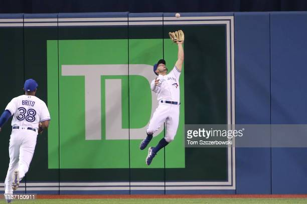 Randal Grichuk of the Toronto Blue Jays makes a leaping catch in the second inning during MLB game action against the Tampa Bay Rays at Rogers Centre...