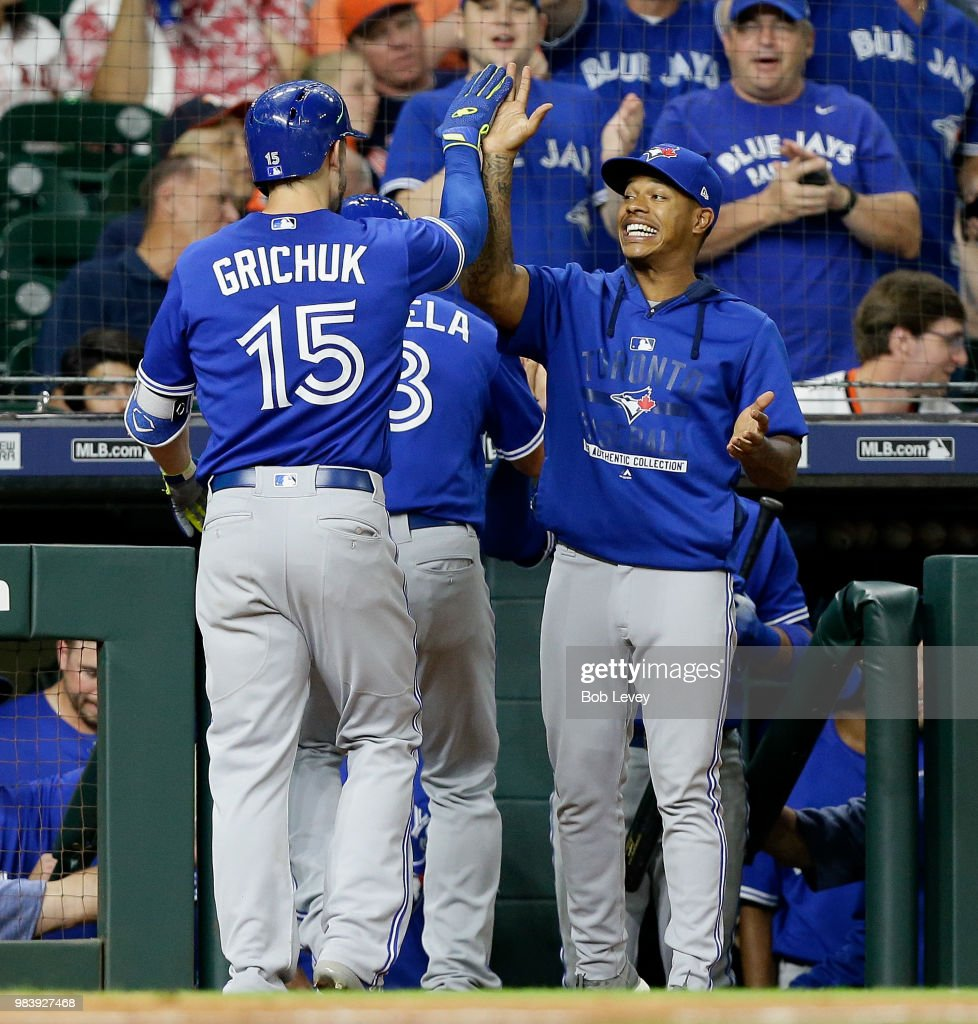 Randal Grichuk #15 of the Toronto Blue Jays receives a high five from Marcus Stroman #6 after hitting a two-run home run against the Houston Astros in the eighth inning at Minute Maid Park on June 25, 2018 in Houston, Texas.