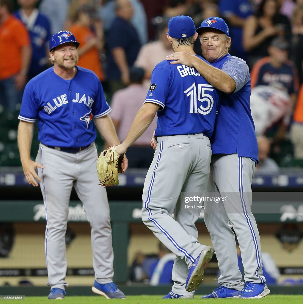 Randal Grichuk #15 of the Toronto Blue Jays receives a hug from manager John Gibbons #5 of the Toronto Blue Jays as they beat the Houston Astros 6-3 at Minute Maid Park on June 25, 2018 in Houston, Texas.