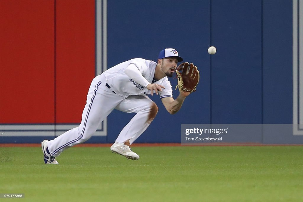 Randal Grichuk #15 of the Toronto Blue Jays runs in to make a catch in the seventh inning during MLB game action against the Baltimore Orioles at Rogers Centre on June 8, 2018 in Toronto, Canada.