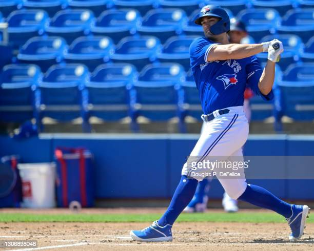 Randal Grichuk of the Toronto Blue Jays swings at a pitch during the second inning against the Baltimore Orioles during a spring training game at TD...