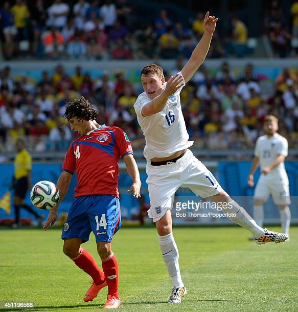 Randall Brenes of Costa Rice is challenged by Phil Jones of England during the 2014 FIFA World Cup Brazil Group D match between Costa Rica and...