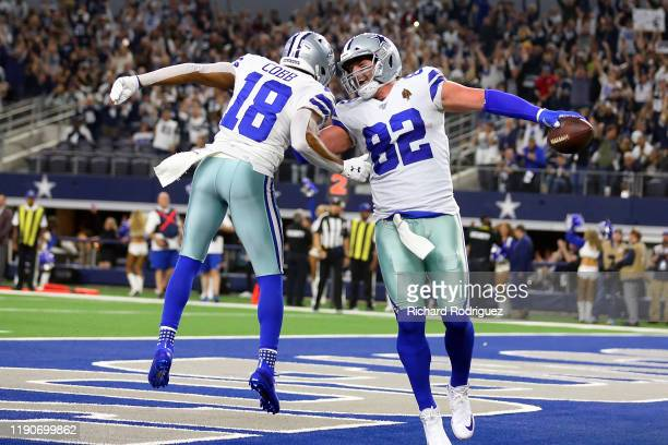 Randall Cobb of the Dallas Cowboys celebrates the first quarter touchdown by Jason Witten of the Dallas Cowboys against the Buffalo Bills at ATT...
