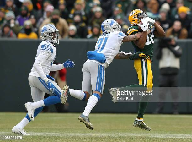Randall Cobb of the Green Bay Packers catches a pass against Teez Tabor of the Detroit Lions during the second half of a game at Lambeau Field on...
