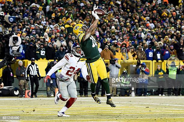 Randall Cobb of the Green Bay Packers catches a touchdown pass against Eli Apple of the New York Giants in the fourth quarter during the NFC Wild...