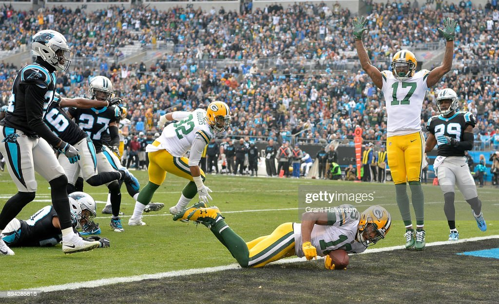Randall Cobb #18 of the Green Bay Packers dives into the end zone for a touchdown against the Carolina Panthers during their game at Bank of America Stadium on December 17, 2017 in Charlotte, North Carolina.