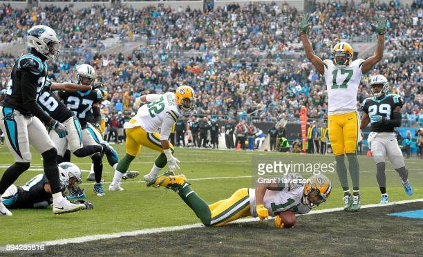 Randall Cobb of the Green Bay Packers dives into the end zone for a touchdown against the Carolina Panthers during their game at Bank of America...