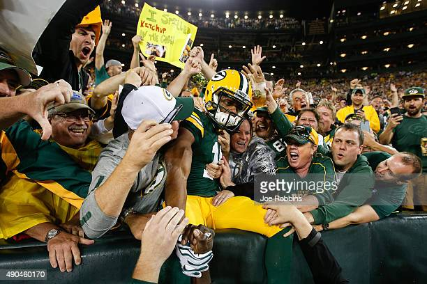 Randall Cobb of the Green Bay Packers does the 'Lambeau Leap' after scoring a touchdown against the Kansas City Chiefs in the first quarter at...