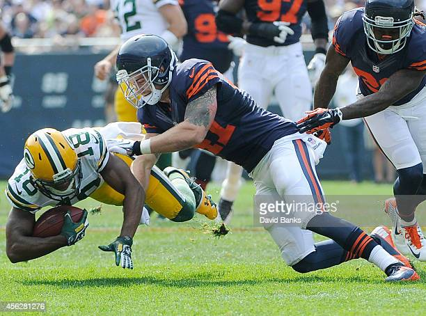 Randall Cobb of the Green Bay Packers is tackled by Chris Conte of the Chicago Bears during the second half on September 28 2014 at Soldier Field in...