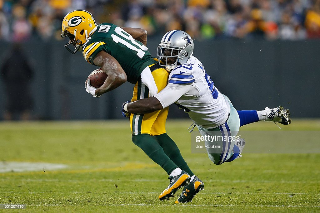 Randall Cobb #18 of the Green Bay Packers is tackled by Rolando McClain #55 of the Dallas Cowboys in the first half at Lambeau Field on December 13, 2015 in Green Bay, Wisconsin. The Green Bay Packers defeated the Dallas Cowboys 28 to 7.