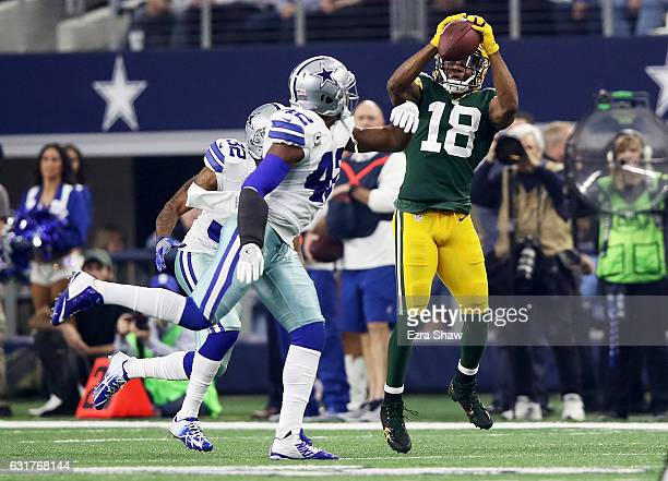 Randall Cobb of the Green Bay Packers makes a catch while being guarded by Barry Church of the Dallas Cowboys in the first half during the NFC...