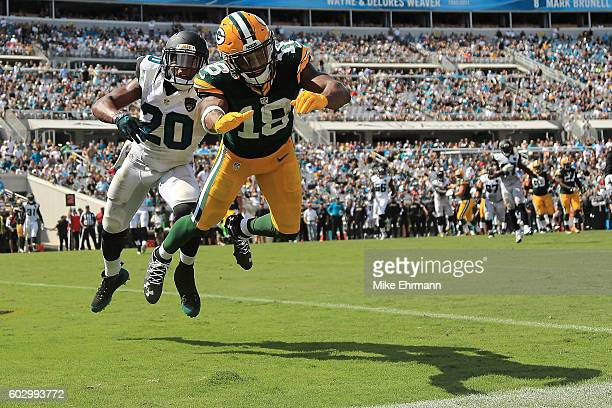 Randall Cobb of the Green Bay Packers misses a catch defended by Jalen Ramsey of the Jacksonville Jaguars during a game at EverBank Field on...