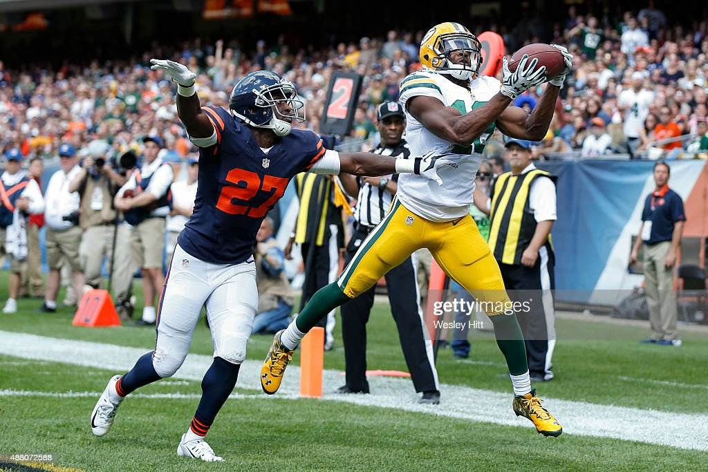 Randall Cobb #18 of the Green Bay Packers receives a 5 yard pass against Sherrick McManis #27 of the Chicago Bears for a touchdown in the fourth quarter at Soldier Field on September 13, 2015 in Chicago, Illinois.