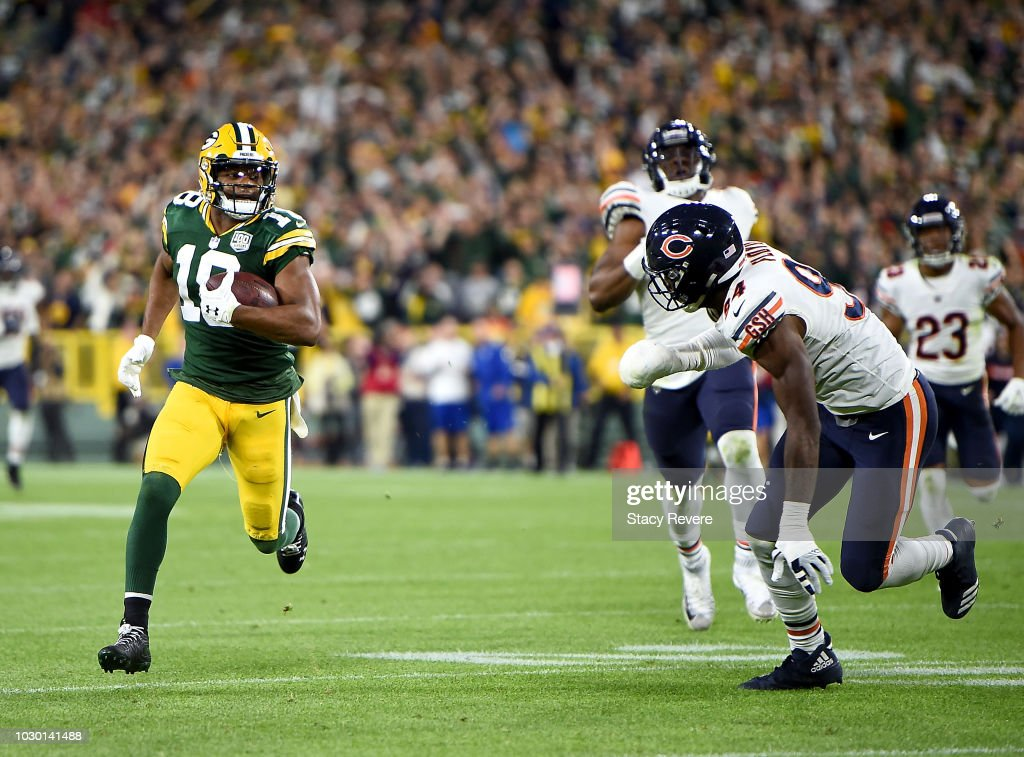 Randall Cobb #18 of the Green Bay Packers runs in for a touchdown past Leonard Floyd #94 of the Chicago Bears during the fourth quarter of a game at Lambeau Field on September 9, 2018 in Green Bay, Wisconsin.