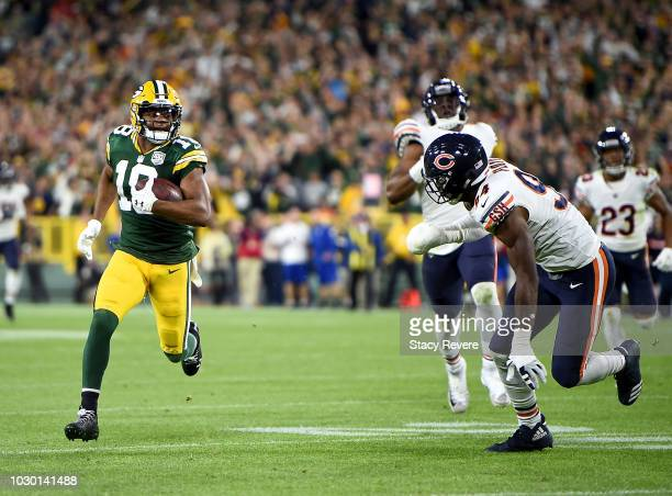 Randall Cobb of the Green Bay Packers runs in for a touchdown past Leonard Floyd of the Chicago Bears during the fourth quarter of a game at Lambeau...