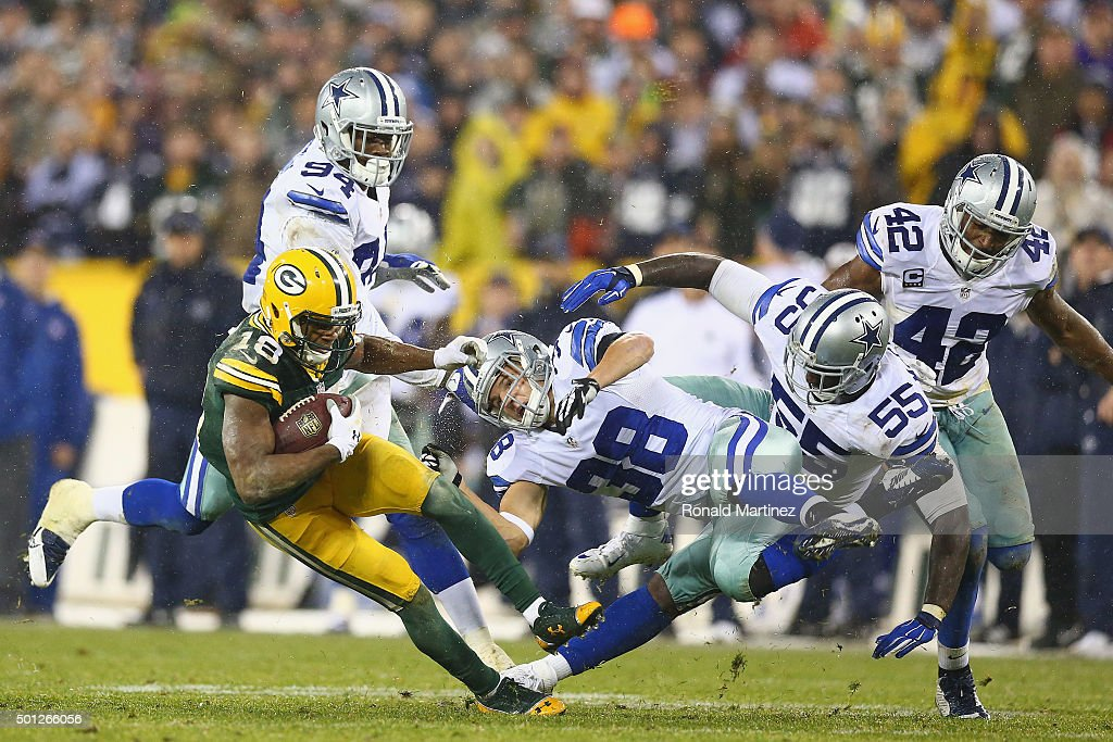 Randall Cobb #18 of the Green Bay Packers runs the ball against Jeff Heath #38 and Rolando McClain #55 of the Dallas Cowboys in the fourth quarter at Lambeau Field on December 13, 2015 in Green Bay, Wisconsin.