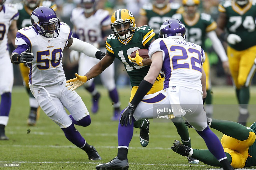 Randall Cobb #18 of the Green Bay Packers runs the ball against the Minnesota Vikings at Lambeau Field on December 2, 2012 in Green Bay, Wisconsin.