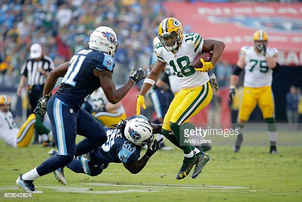 Randall Cobb of the Green Bay Packers runs with the ball while defended by Sean Spence of the Tennessee Titans at Nissan Stadium on November 13 2016...