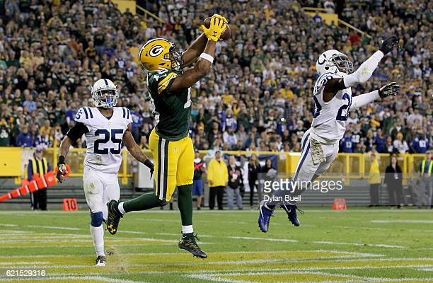 Randall Cobb of the Green Bay Packers scores a touchdown between Patrick Robinson and Darius Butler of the Indianapolis Colts in the fourth quarter...