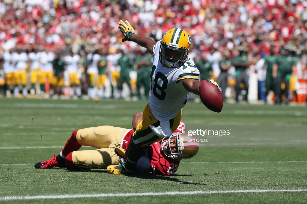Randall Cobb #18 of the Green Bay Packers stretches across the goal line for a touchdown in the first quarter during an NFL game against San Francisco 49ers at Candlestick Park on September 8, 2013 in San Francisco, California.