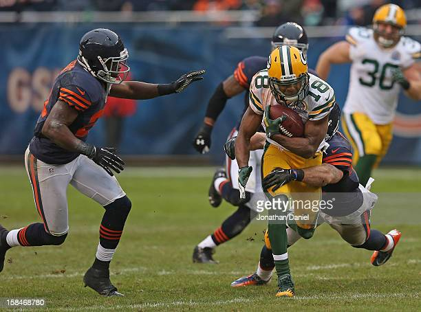 Randall Cobb of the Green Bay Packers tries to break away from Chris Conte and Major Wright of the Chicago Bears at Soldier Field on December 16 2012...