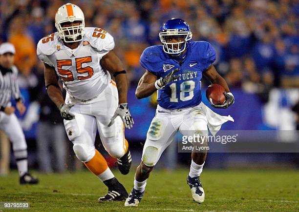 Randall Cobb of the Kentucky Wildcats runs with the ball while defended by Dan Williams of the Tennessee Volunteers during the SEC game at...