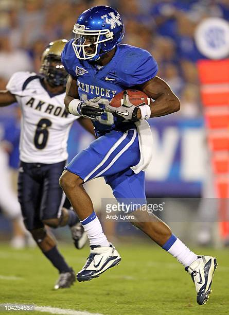 Randall Cobb of the Kentucky Wildcats scores a touchdown against the Akron Zips during the game at Commonwealth Stadium on September 18 2010 in...