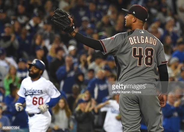 Randall Delgado of the Arizona Diamondbacks stands on the mound as Andrew Toles of the Los Angeles Dodgers rounds the bases after a two run home run...