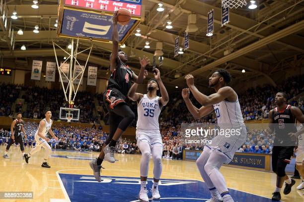 Randall Gaskins Jr #4 of the St Francis Red Flash goes to the basket against Marvin Bagley III of the Duke Blue Devils at Cameron Indoor Stadium on...