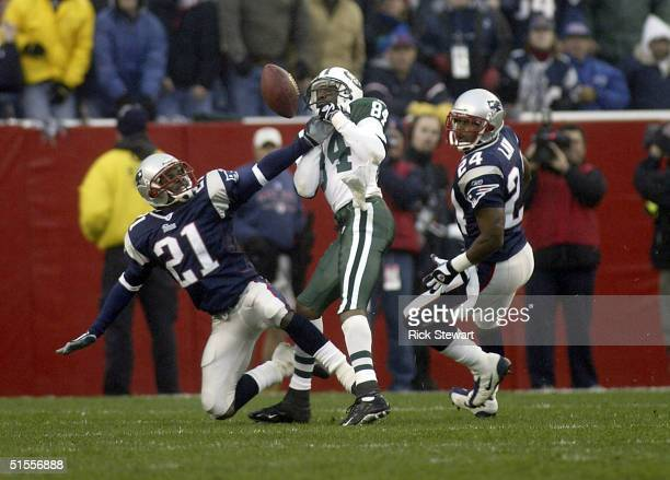 Randall Gay of the New England Patriots breaks up a catch attempt by Jonathan Carter of the New York Jets as Ty Law of the Patriots watches on...