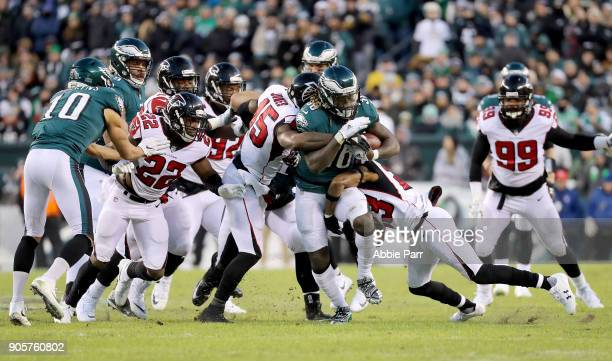 Randall Goforth of the Philadelphia Eagles runs the ball against Deion Jones of the Atlanta Falcons in the first quarter during the NFC Divisional...