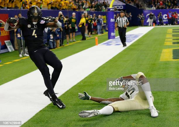 Randall Haynie of the Vanderbilt Commodores intercepts a pass after Denzel Mims of the Baylor Bears lost control when he hit the ground during the...