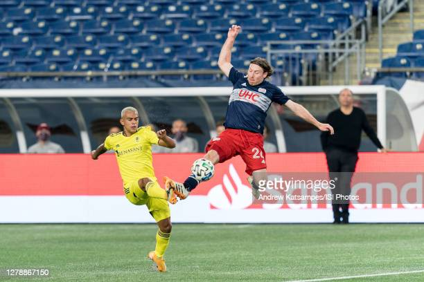 Randall Leal of Nashville SC and Tommy McNamara of New England Revolution battle for the ball during a game between Nashville SC and New England...