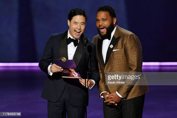 Randall Park and Anthony Anderson speak onstage during the 71st Emmy Awards at Microsoft Theater on September 22, 2019 in Los Angeles, California.