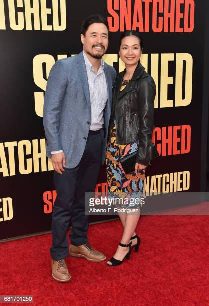 Randall Park and Jae Suh Park attend the premiere of 20th Century Fox's Snatched at Regency Village Theatre on May 10 2017 in Westwood California