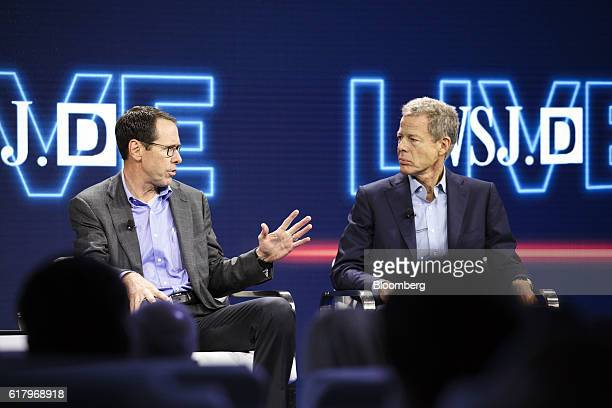 Randall Stephenson chairman and chief executive officer of ATT Inc left speaks while Jeffrey Jeff Bewkes chairman and chief executive officer of Time...