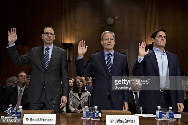 Randall Stephenson chairman and chief executive officer of ATT Inc from left Jeffrey Jeff Bewkes chairman and chief executive officer of Time Warner...