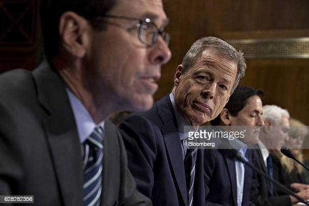Randall Stephenson chairman and chief executive officer of ATT Inc from left speaks while Jeffrey Jeff Bewkes chairman and chief executive officer of...