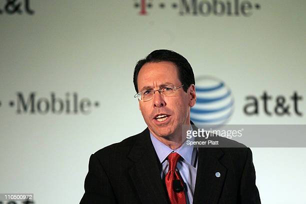 Randall Stephenson, chief executive officer and president of AT&T, speaks at a news conference where it was announced that AT&T Inc. Will be buying...