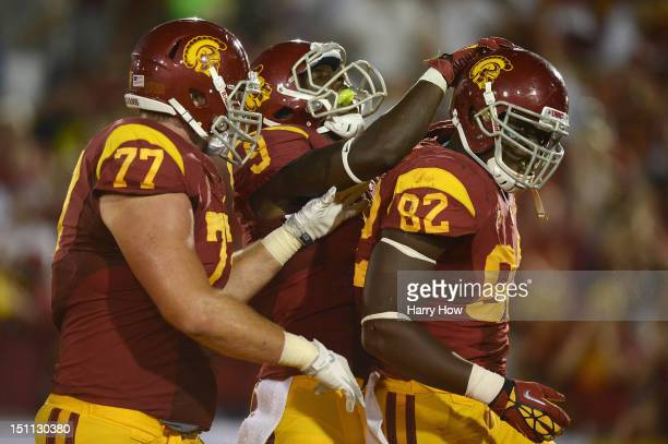 Randall Telfer of the USC Trojans celebrates his touchdown with Marqise Lee and Kevin Graf during a 4910 win over the Hawaii Warriors at Los Angeles...
