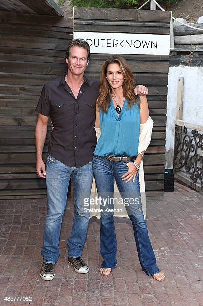 Rande Gerber and Cindy Crawford attend Kelly Slater John Moore and Friends Celebrate the Launch of Outerknown at Private Residence on August 29 2015...