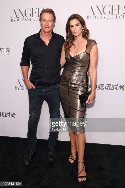 Rande Gerber and Cindy Crawford attend Russell James' launch of his photobook and exhibition 'Angels' at Stephan Weiss Studio on September 6 2018 in...