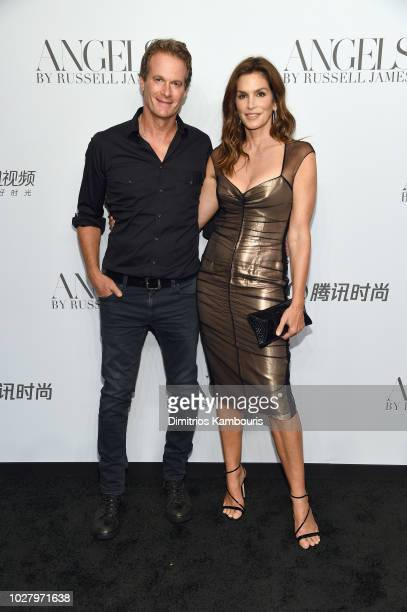 Rande Gerber and Cindy Crawford attend the 'ANGELS' by Russell James book launch and exhibit hosted by Cindy Crawford and Candice Swanepoel at...