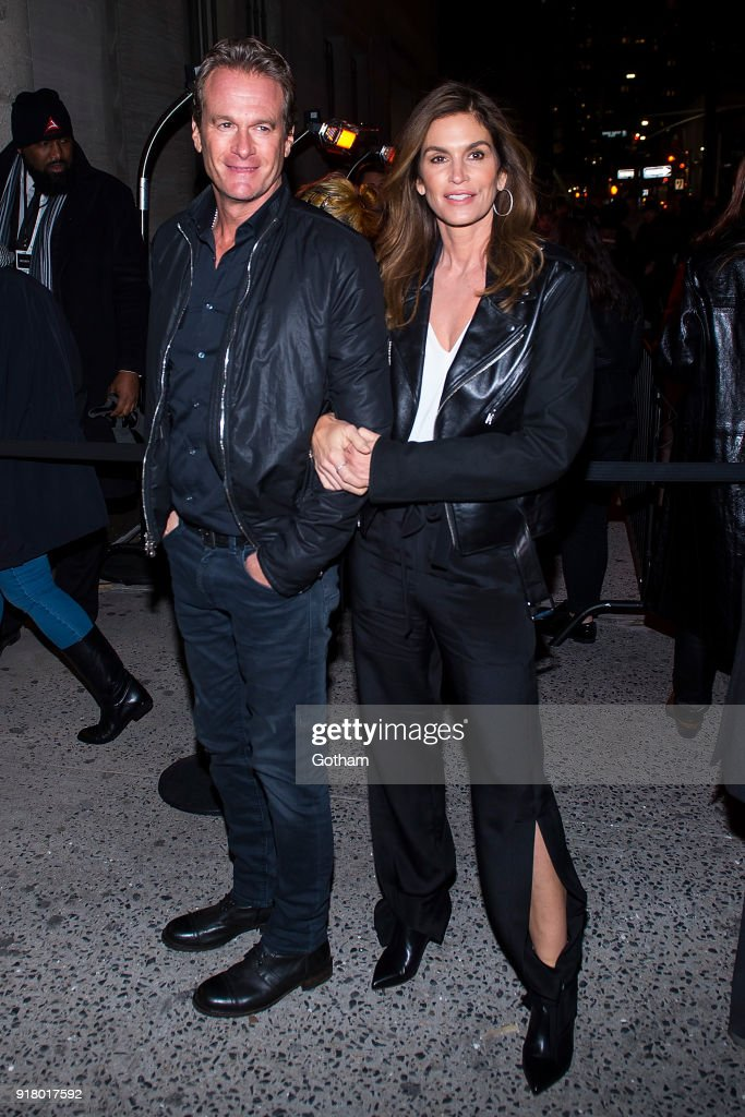 Rande Gerber (L) and Cindy Crawford attend the Calvin Klein fashion show during New York Fashion Week at the American Stock Exchange Building on February 13, 2018 in New York City.