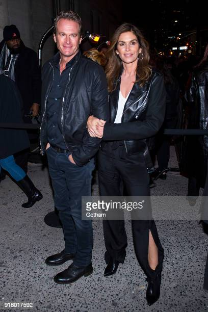 Rande Gerber and Cindy Crawford attend the Calvin Klein fashion show during New York Fashion Week at the American Stock Exchange Building on February...