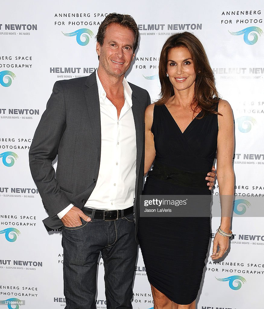 Rande Gerber and Cindy Crawford attend the opening of 'Helmut Newton: White Women - Sleepless Nights - Big Nudes' at Annenberg Space For Photography on June 27, 2013 in Century City, California.