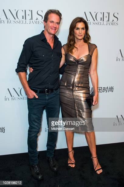 Rande Gerber and Cindy Crawford attend the Russell James 'Angels' book launch exhibit at Stephan Weiss Studio on September 6 2018 in New York City