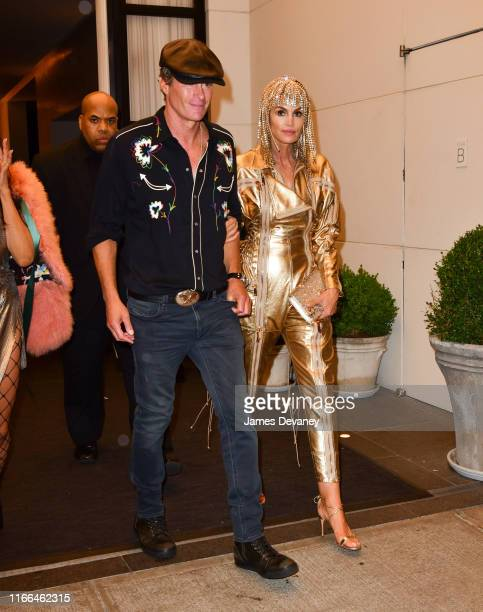 Rande Gerber and Cindy Crawford leave Times Square EDITION on September 6, 2019 in New York City.