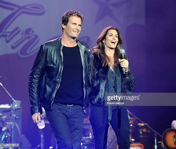 """Rande Gerber and Cindy Crawford on stage during """"Born Free"""" tour opener at Ford Field on January 15, 2011 in Detroit, Michigan."""